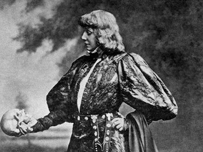Actor dressed as Hamlet contemplates a skull