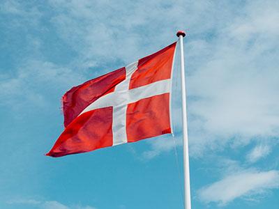 Danish flag against blue sky